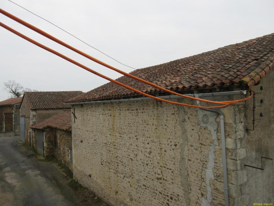 Unsupported conduit between the buildings
